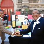 men-shake-hands-at-ministry-fair (Bob Gore)