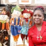 Harvest-Fair-woman-with-scarecrows (Bob Gore)