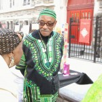 Man-in-green-dashiki-outside-abyssinian (Bob Gore)